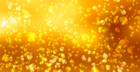 Beer bubbles on a bright gold background photo