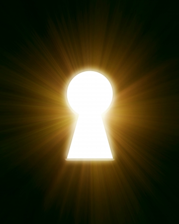 light from the keyhole on a black background photo