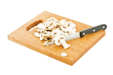 sliced mushrooms on a bamboo board, isolated on white Stock Photo - 16487211