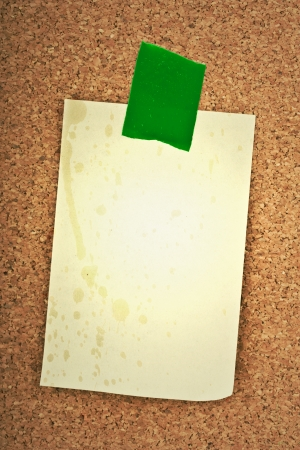 blank sticker glued red ribbon to a cork board Stock Photo - 16487623