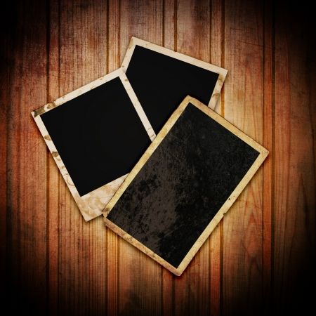 Blank picture frame on the grunge wood background  photo