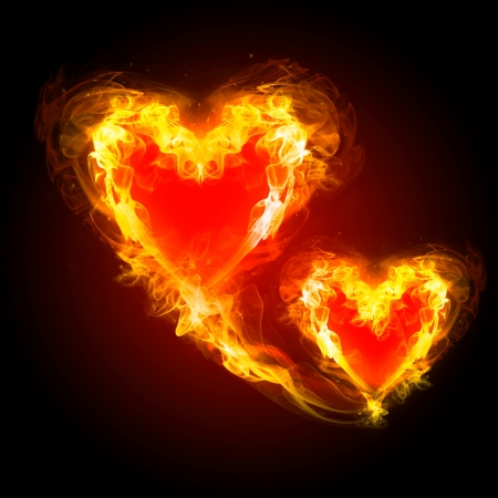 schematically: burning hearts with fireworks on a dark background Stock Photo