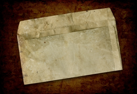 Vintage grungy old envelope. Dirt, folds and creases