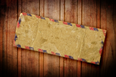 Vintage old airmail envelope on a dark background photo