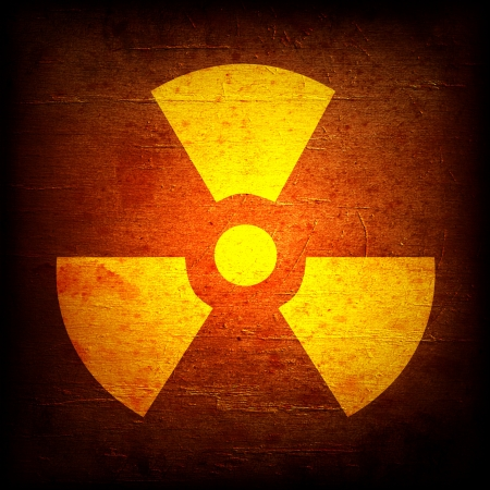 caution chemistry: radioactivity symbol on a grungy barrel background