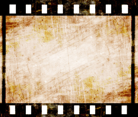 movie camera: old film strip with some spots Stock Photo