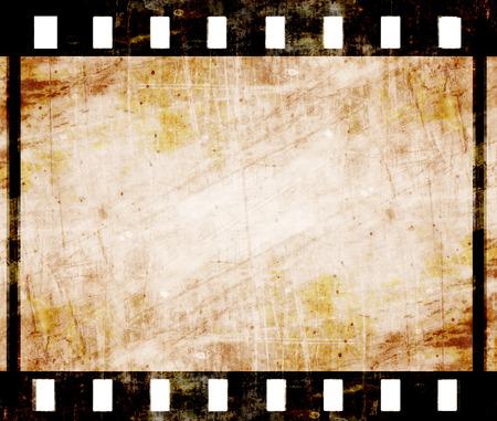 cinta de pelicula: tira de película antigua con algunas manchas Foto de archivo