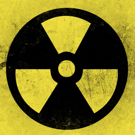 barrel bomb: radioactivity symbol on a grungy barrel background