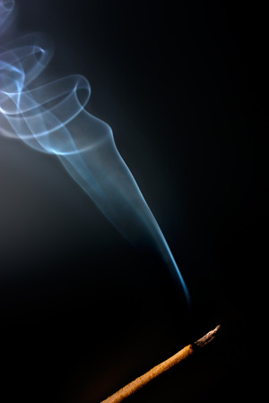 fengshui: Incense Stick with Smoke on Black Background