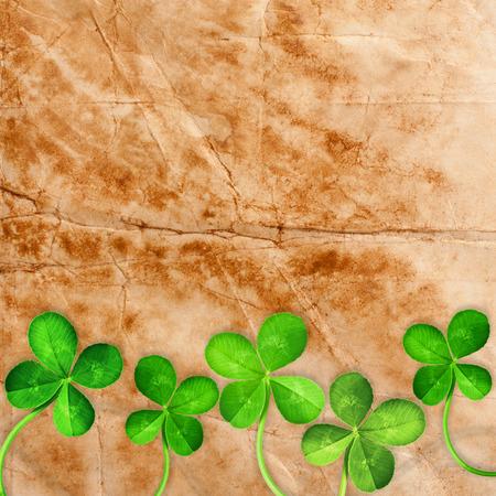 fourleafed: Four Leaf Clover on old paper