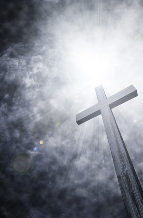 religious celebration: wooden cross on dark sky, abstract background