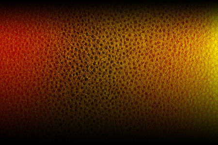 resplendence: texture gold-embossed leather with uneven illumination Stock Photo