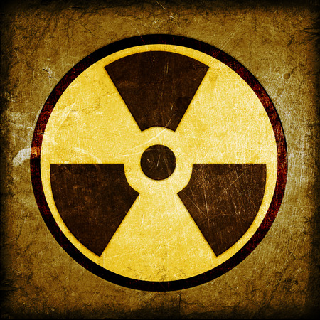 caution chemistry: radioactivity symbol on a grungy barrel background
