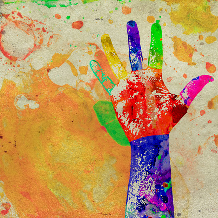 splashed: abstract grunge poster of a hand with watercolor stains Stock Photo
