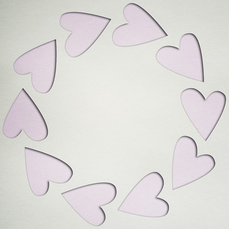 basic scheme: paper background with frame of hearts Stock Photo