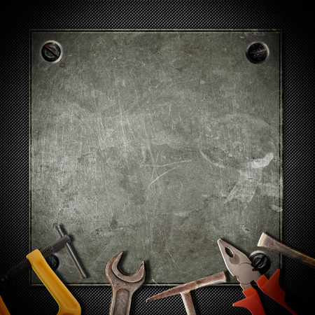 tools for repairs on the grunge background photo