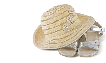 summer hat with silver sandals, isolated on white Stockfoto