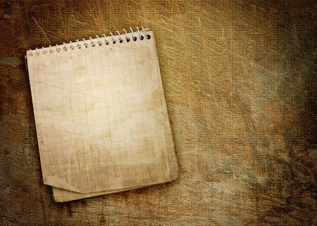 old used notebook on grunge background Фото со стока