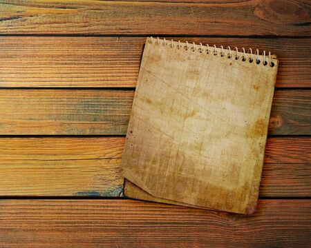 old used notebook on a wooden background  Фото со стока