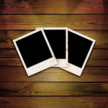 Three empty grunge frame for your photo on a wooden background Фото со стока