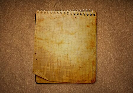 dirty old notebook in a darkened background
