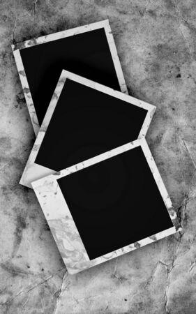 Blank photo frames on grunge background