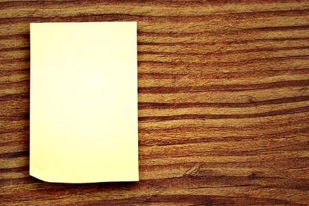 blank sticker glued to a wood background