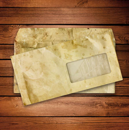 old envelopes with some spots on a wooden background Stockfoto