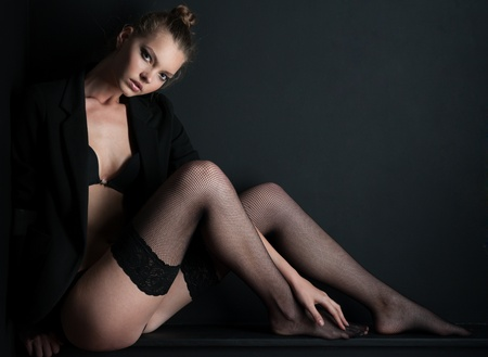 Photography models posing in stockings and sitting on a blackboard Stock Photo - 8673889