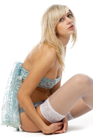 sad blonde posing in white stockings photo