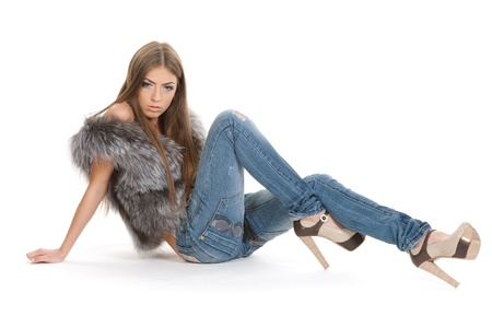 Cute brunette in jeans posing photo