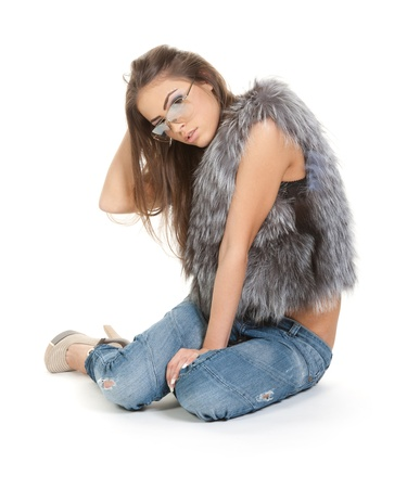 Graceful brunette in jeans and fur photo
