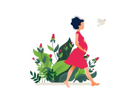 Happy young pregnant woman walking in the beautiful garden. Active well fitted pregnant female character.