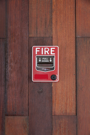 Push button switch fire on wood pattern wall photo
