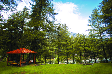 pavillion: Lonely Wooden Pavillion in the park with Himalaya Stock Photo