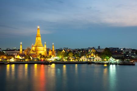 chao phraya river: The beautiful temple along the Chao Phraya river at twilight