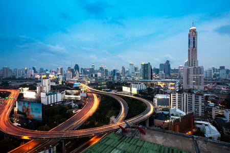 Bangkok Highway at Dusk with skyline in Thailand  photo