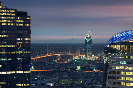 Bangkok Highway at Dusk with the business district  Thailand  photo