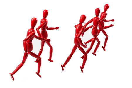 Red wooden art model group running away into the distance photo
