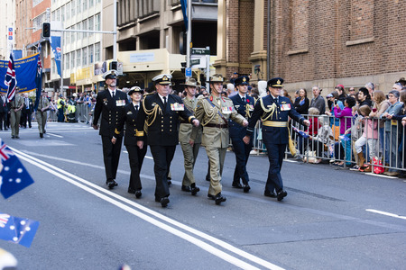 armed services: Senior officers of all the armed forces march in sync past the crowd down Elizabeth St