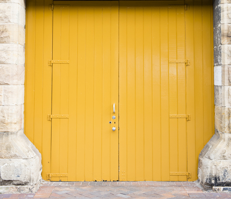 large doors: Large yellow wooden doors
