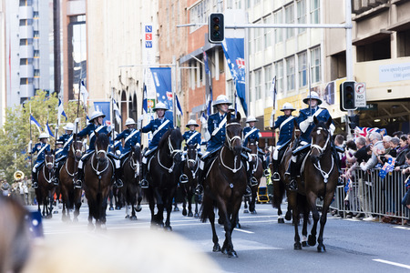 police unit: The NSW mounted police unit trots by the crowd along Elizabeth St