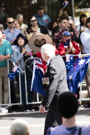 armed services: Veteran taking his hat off to the crowd while marching down Elizabeth St Editorial