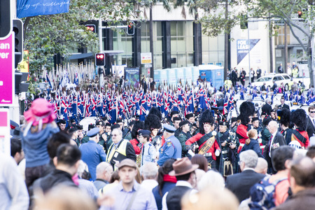 armed services: The first unit of marchers is holding their flags at the ready waiting for the start of the march along Elizabeth Street