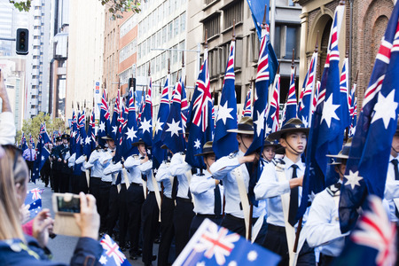 armed services: The airforce cadet unit marches by the crowd along Elizabeth St holding their flags high