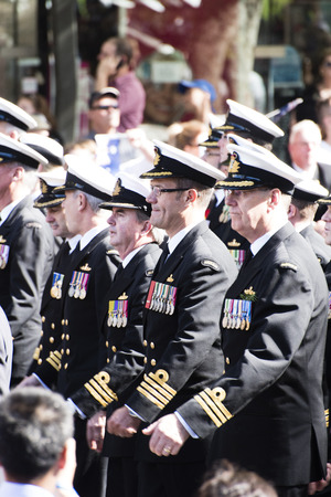marching: Naval officers marching in sync as the pass by the crowd as they move along Elizabeth St