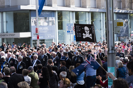 armed services: Submariners march down Elizabeth St carrying the skull and crossbones banner Editorial