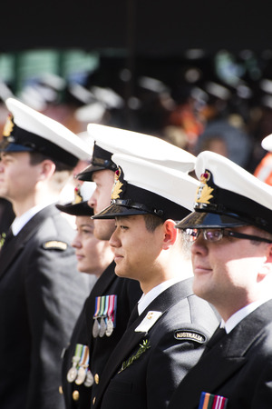 armed services: Naval officers smiling as they march down Elizabeth St