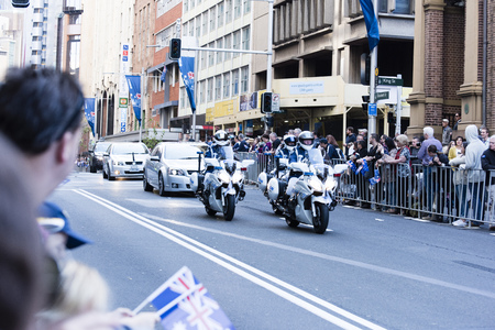 lt: Police motorcycle escorts the Lt. Governor of NSW along Elizabeth Street at the head of the procession