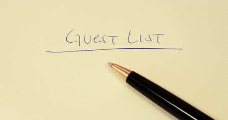 guest list on a paper with pen photo